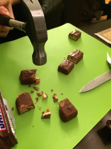 Frozen Snickers divided scientifically with a hammer.